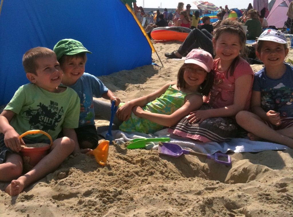 My kids Natasha & Aleck with friends on the beach