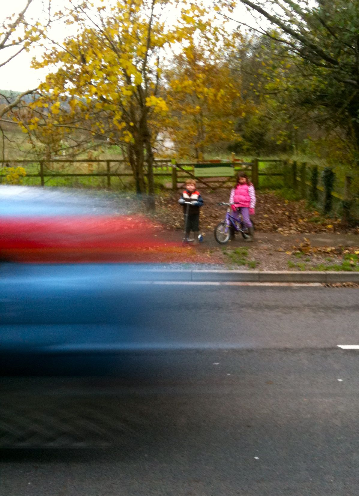 This is a picture of my children waiting to cross the road near Honiton Bottom Road with cars whizzing past!