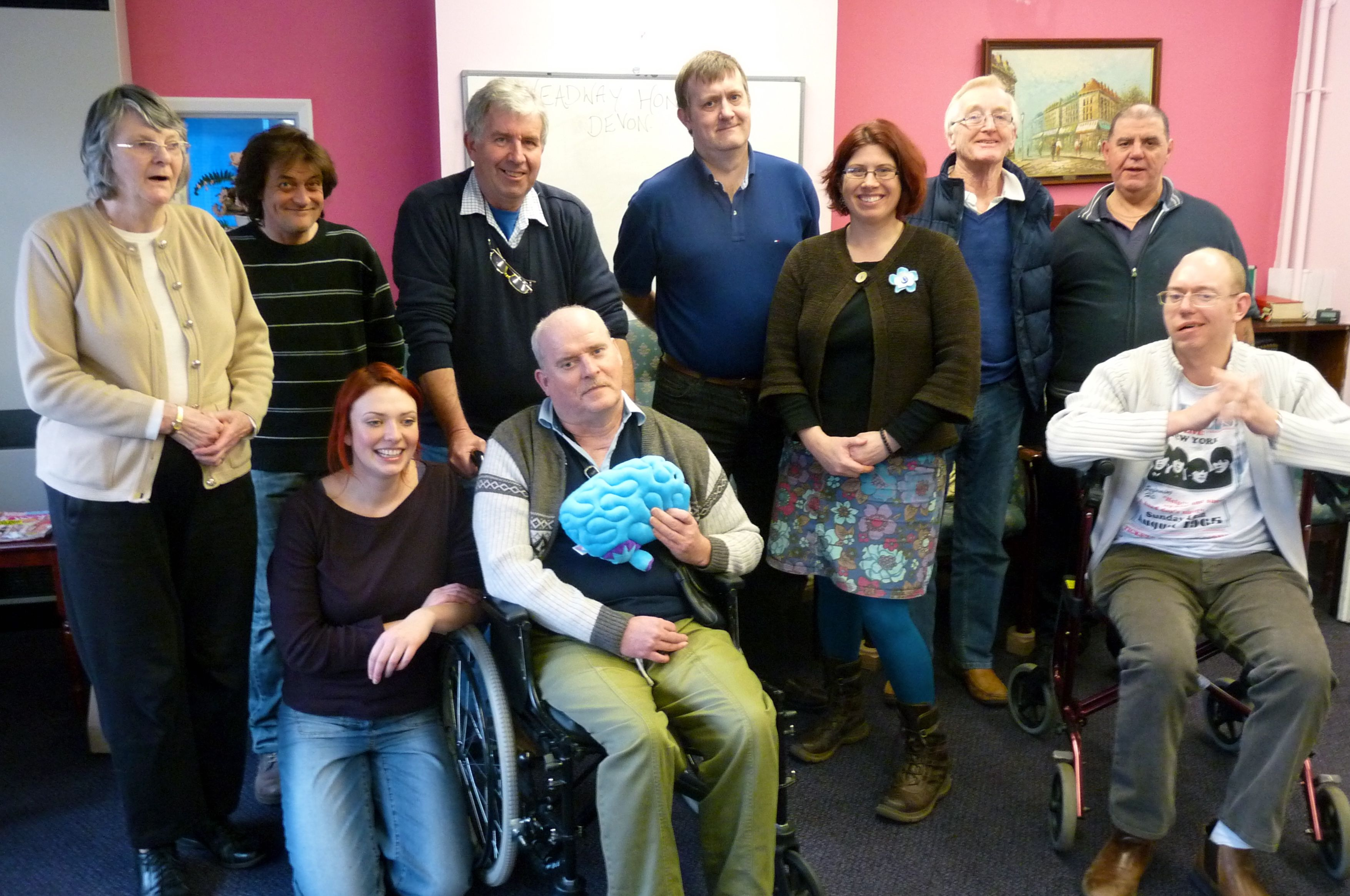 Honiton Town Councillor Sharon Pavey (4th from right) with staff, volunteers and clients of Headway in Honiton